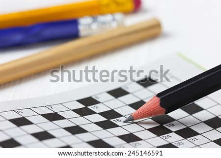crossword puzzle and pencils - stock photo