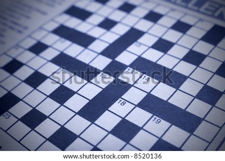 Crossword puzzle with blue tint and left blank, shallow DOF - stock photo