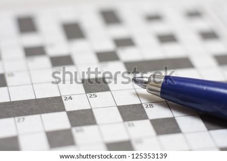 Crossword puzzle with pen - stock photo