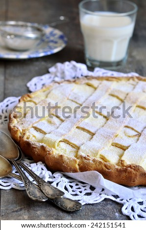 Crostata with ricotta on a rustic background. - stock photo