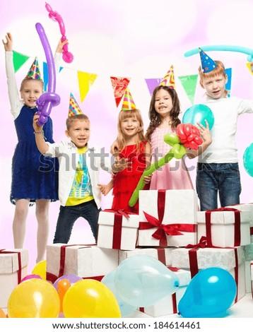 Croup of happy children celebrating birthday - stock photo