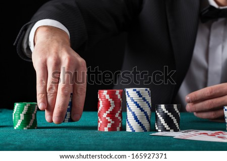 Croupier chip tricks on green casino table