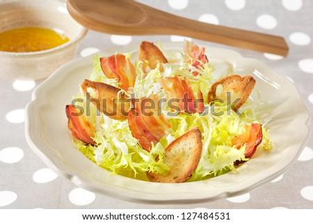 Croutons salad with crispy bacon - stock photo