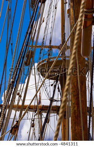 Crow's nest through the rigging of a sailing ship.