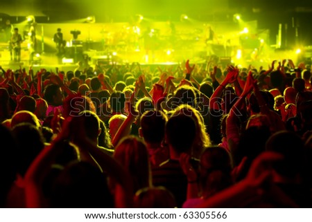 Crowd at a concert, back light silhouette