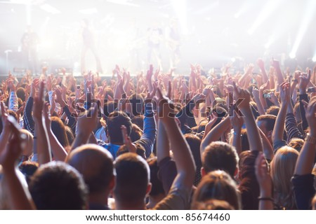 Crowd at a concert with hands up - stock photo