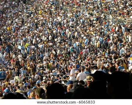 Crowd at a football game. - stock photo