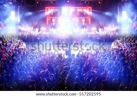 crowd at a rock concert spotlight background blur