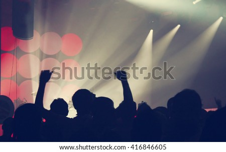 Crowd at concert and blurred colorful stage lights - stock photo