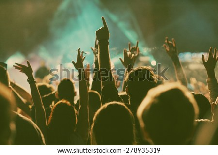Crowd at concert - retro style photo - stock photo