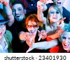 Crowd cheering - their rock idol or simply having fun in a club (Focus on hands!) - stock photo