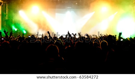 Crowd, colorful lights at concert - stock photo