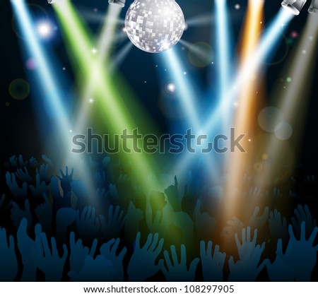 Crowd dancing at a concert or on a disco nightclub dance floor with hands up under a mirror ball with lights - stock photo
