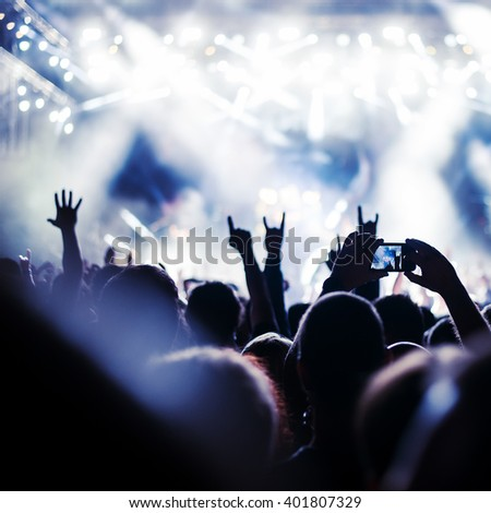 Crowd enjoying a great party. - stock photo