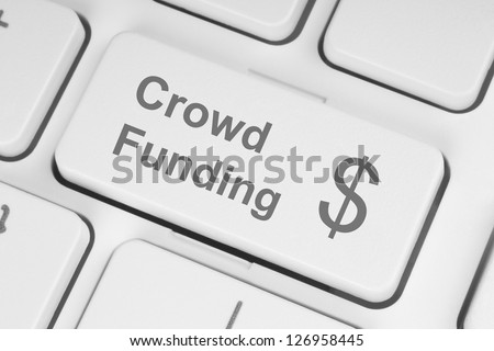 Crowd funding button on keyboard - stock photo