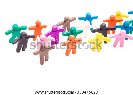 Crowd group of colourful plasticine humans on the white.