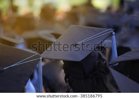 Crowd image of students at graduation ceremony from behind