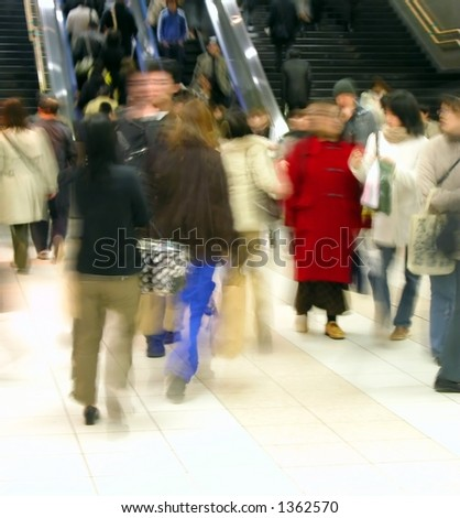 crowd in motion in a train station