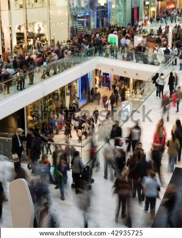 Crowd in the mall (motion blurred) - stock photo