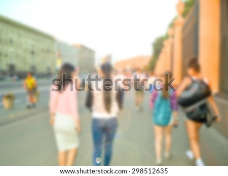 Crowd of blurred walking and talking young people in city. - stock photo