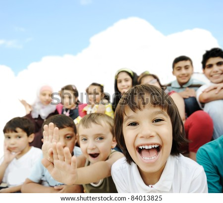 Crowd of children, sitting together happily - stock photo