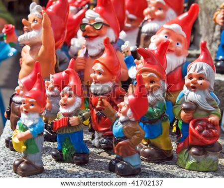 Crowd of colorful dwarf figures - stock photo
