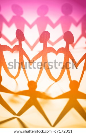 Crowd of colorful people holding hands - stock photo