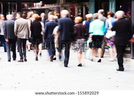 crowd of dressed up people walking to a concert - stock photo