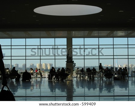 Crowd of people dining at the airport lounge - stock photo