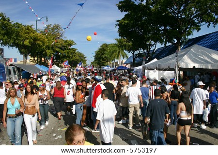 """Crowd of people gathered at the """"Calle Ocho"""" Carnival in Miami Florida USA. - stock photo"""