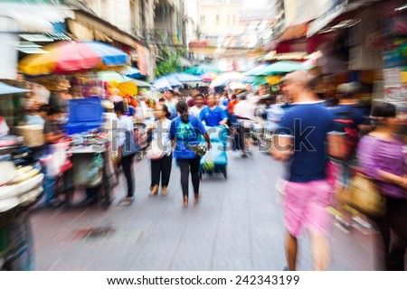 crowd of people in Chinatown in Bangkok, Thailand, with intentional zoom effect