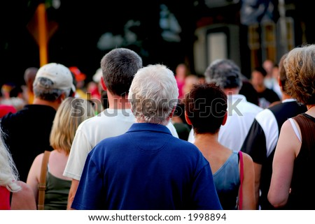 Crowd of people on busy city street - stock photo