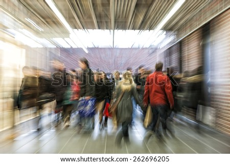 Crowd of people rushing through corridor, zoom effect, motion blur, cross balance - stock photo