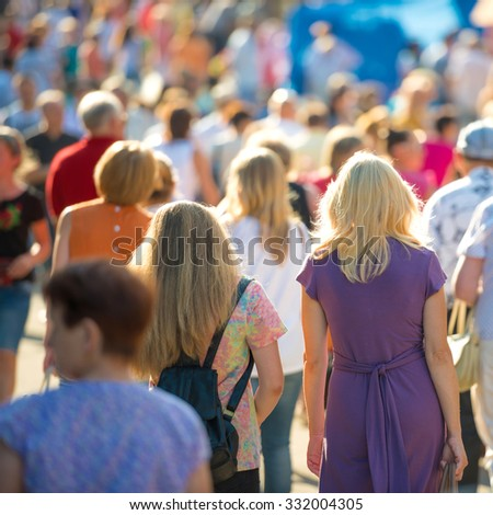 Crowd of people walking on the busy city street.  - stock photo