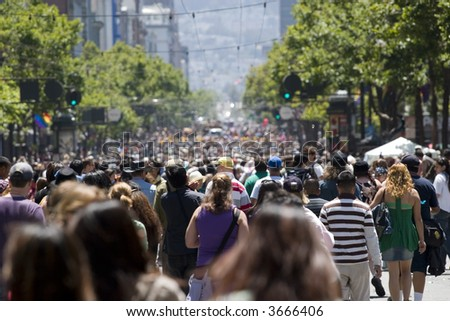 Crowd of people walking on the street shallow depth of field - stock photo