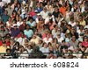 Crowd of people watching a high  school graduation. Editorial use only. - stock photo