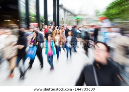 crowd of shopping people in the city with zoom effect - stock photo