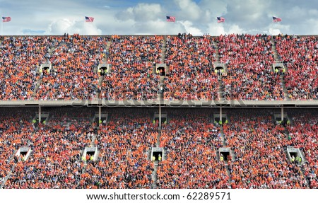 Crowd of thousands dressed in orange