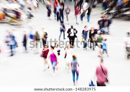 crowd of traveling people on a station courtyard with creative zoom effect - stock photo