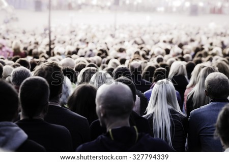 Crowd of unrecognisable people. Slow shutter speed motion blur for unrecognizability. - stock photo