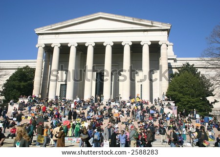 Crowd on steps of Smithsonian Art Museum at anti war rally on the National Mall, Washington, DC, Saturday, January 27, 2007. - stock photo