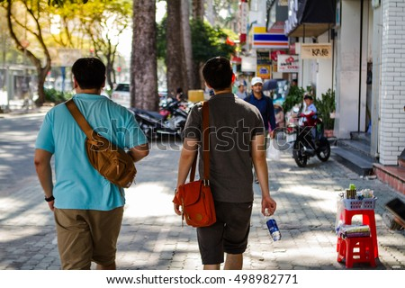 Crowd on street with beautiful morning light, Ho Chi Minh City, Vietnam, Asia.
