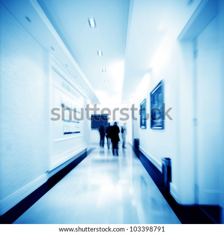 Crowd walking in a corridor