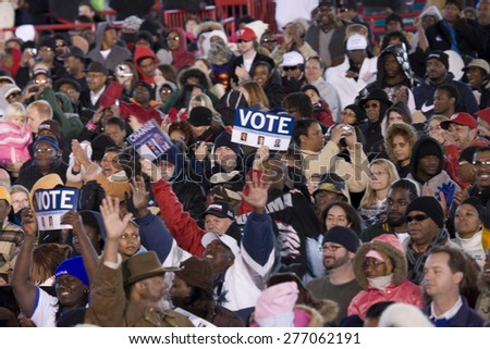 Crowd with signs for US Senator Barack Obama Early Vote for Change Presidential rally, October 25, 2008 at Bonanza High School, Judy K. Cameron Stadium in Las Vegas, NV - stock photo