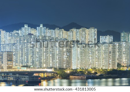 crowded highrise residential building in Hong Kong City - stock photo