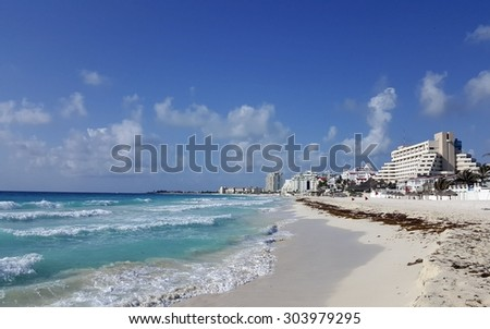 Crowded hotel zone along Caribbean sea coast, always warm and sunny Cancun, Mexico