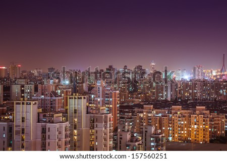crowded shanghai buildings at night - stock photo