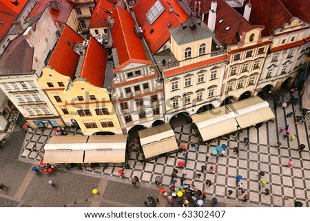 crowded square in the rain, Prague city, Czechia - stock photo