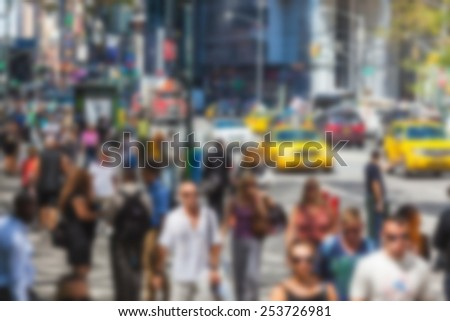 Crowded 5th Avenue with tourists and taxi. Blurred Background. - stock photo
