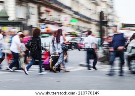 crowds of people crossing the street in the big city - stock photo
